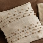 Aziza pillow hand-curled details